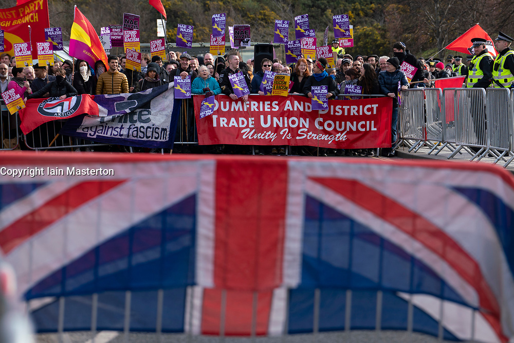 Edinburgh, Scotland, UK. 23 March, 2019. March to the Scottish Parliament in Edinburgh by far-right Scottish Defence League (SDL) was met by a counter demonstration by several left wing groups such as Unite Against Fascism, Muslin Women's Association and Edinburgh Antifa. A heavy police presence was in force and the SDL were closely escorted to and from Waverley Station.