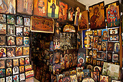 "Shop selling religious icons, paintings and pictures in the area of Monastiraki. Among religions in Greece, the largest denomination is the Greek Orthodox Church, which represents the majority of the population and which is constitutionally recognised as the ""prevailing religion"" of Greece (making it one of the few European countries with a state religion). Other major religions include Catholicism, Islam and Protestantism. According to a 2005 Eurobarometer Poll, 81% of Greek citizens believe that there is a God, whereas 16% believed in some sort of spirit or life force and 3% responded that they did not believe there is any sort of God, spirit or life force. Athens is the capital and largest city of Greece. It dominates the Attica periphery and is one of the world's oldest cities, as its recorded history spans around 3,400 years. Classical Athens was a powerful city-state. A centre for the arts, learning and philosophy."