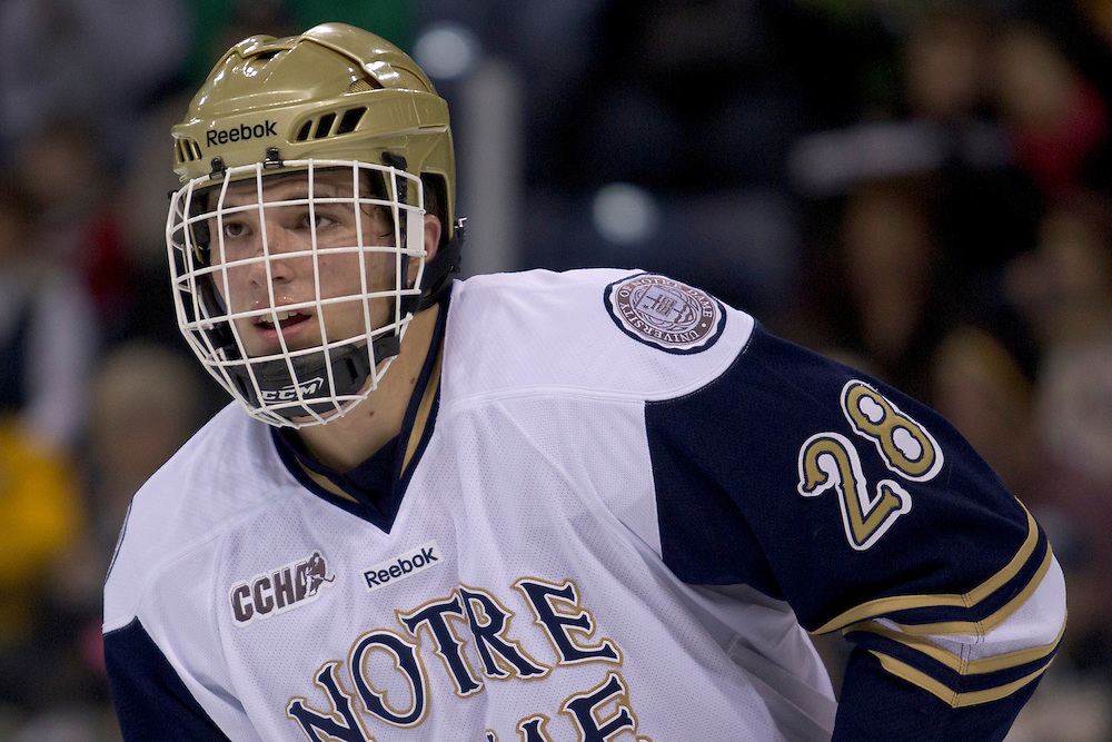 Notre Dame defenseman Stephen Johns (#28) in first period action during NCAA hockey game between Notre Dame and Northeastern.  The Northeastern Huskies defeated the Notre Dame Fighting Irish 9-2 in game at the Compton Family Ice Arena in South Bend, Indiana.