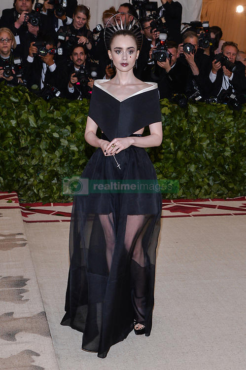 Lily Collins walking the red carpet at The Metropolitan Museum of Art Costume Institute Benefit celebrating the opening of Heavenly Bodies : Fashion and the Catholic Imagination held at The Metropolitan Museum of Art  in New York, NY, on May 7, 2018. (Photo by Anthony Behar/Sipa USA)