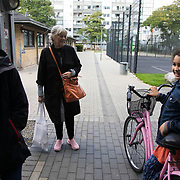 Daily life. Lundtoftegade is a housing estate in the heart of Copenhagen. The estate has been on the controversial Ghetto List for years but wastaken off 1st of December 2020. The Ghetto List is based on the Ghetto Law introduced by the Danish Govenrment in 2018. In 2020 a huge campaign was launched to raise 50.000 signatures demanding the Danish Parliament to reconsider the law and to abolish it. Part of the campaign was the national portrait poster campaign 'We ARE the mixed city'. More than 100 local residents in joined the campaign and were photographed in a small make shift studio set up in Lundtoftegade. These images are fragments of life in and around Lundtoftegade 2020.
