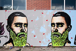 © Licensed to London News Pictures. 25/07/2015. Bristol, UK.  Piece titled 'Essential Altruism' by id-iom at Upfest 2015, Europe's largest, free, street art & graffiti festival, attracting over 250 artists painting 28 venues throughout Bedminster & Southville, Bristol.  Talented artists travel from 25 countries and across the UK to paint live on 30,000sqft of surfaces in front of 25,000 visitors. There is also an affordable art sale, music stages and art workshops.  Photo credit : Simon Chapman/LNP