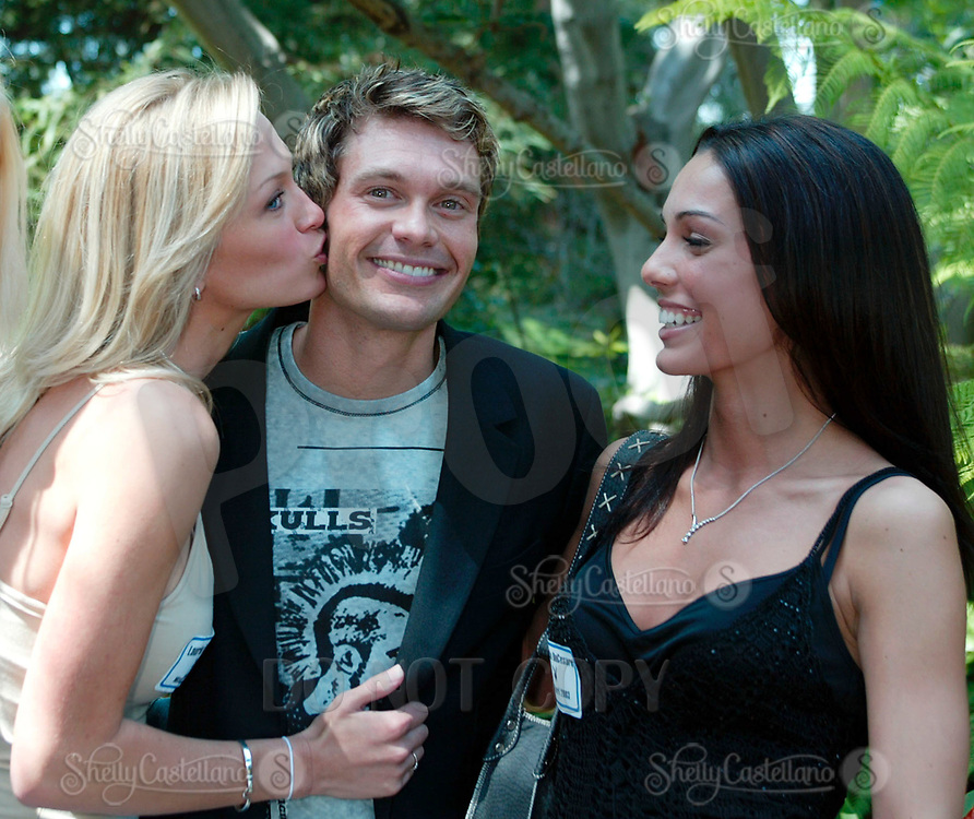 Apr 24, 2003; Holmby Hills, CA, USA; 'I can honestly say, by the feelings I have right now, I am not gay, said 'American Idol' host RYAN SEACREST seen here with (L-R) Playmates LAURIE FETTER & CARMELLA DECESARE @ 2003 Playboy Playmate of the Year party held @ the Playboy Mansion.<br />Mandatory Credit: Photo by Shelly Castellano/ZUMA Press.<br />(©) Copyright 2003 by Shelly Castellano