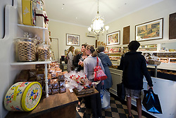 """Shoppers cue for the tasty treats at Philip's Bicuit's in Antwerp, Belgium, Saturday, Sept. 13, 2008. Phiip's is famous for their """"hand biscuits"""" which is part of Antwerp folklore. (Photo © Jock Fistick)"""
