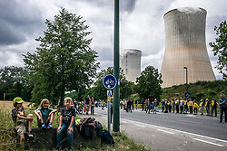 June 25, 2017 - Tihange, Wallonie, Belgium - Belgian, Dutch and German citizens  hold the prostest in near the nuclear power plant of Tihange, Belgium on 25.06.2017 Protestors created 90 km long a human chain  starting in Tihange, passing by Maastricht in the Netherlands and ending in Aachen, Germany. The organizers of the action demand the immediate shutdown of the nuclear power plants Tihange 2 and Doel 3. by Wiktor Dabkowski (Credit Image: © Wiktor Dabkowski via ZUMA Wire)