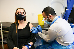 © Licensed to London News Pictures. 29/05/2021. London, UK. Pharmacist Huseyin Akpinar administers the AstraZeneca vaccine to a woman at a Covid-19 vaccination centre in Tottenham, north London. Public Health England data shows that just under 7,000 cases of the Indian variant have been confirmed in the UK. Photo credit: Dinendra Haria/LNP
