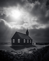 Moody black and white image of the famed black church at Budakirkja, Iceland