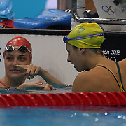 A girl moment as Great Britain swimmer Keri-anne Payne shows her engagement ring to Australian swimmer Stephanie Rice during swim training at the Olympic Aquatic Centre.  In September Payne will tie the knot with fiancé and fellow swimmer David Carry in his hometown of Aberdeen. The Aquatic Centre at Olympic Park, Stratford during the London 2012 Olympic games preparation at the London Olympics. London, UK. 26th July 2012. Photo Tim Clayton