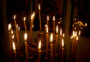 Israel Capernahum sea of Galilee, interior of the Greek Orthodox Church of the Twelve Apostles, lit ceremonial candles