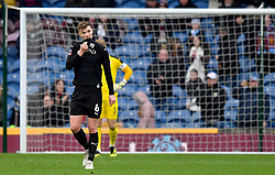 Barnsley's Liam Lindsay appears dejected after Burnley's Chris Wood scores his side's first goal of the game from the penalty spot during the Emirates FA Cup, third round match at Turf Moor, Burnley.