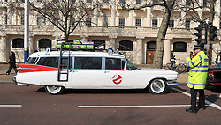©London News pictures. 08/03/11. The car from The Ghotsbusters movies is photographed by a police officer. Famous cars from TV and Film drive down the mall in London today (08/03/2011) as part of a publicity stunt for NetCars.com  Picture Credit should read Stephen Simpson/LNP