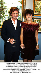 Artist HARRY HOLCROFT and his wife SARAH, at an exhibition in London on 24th November 2003.POX 8