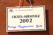 In the Chapoutier winery. A concrete fermentation vat with a sign saying it contains  Crozes Hermitage 2002 red Meysonniers Bio (organically grown vines)  Domaine M Chapoutier, Tain l'Hermitage, Drome Drôme, France Europe