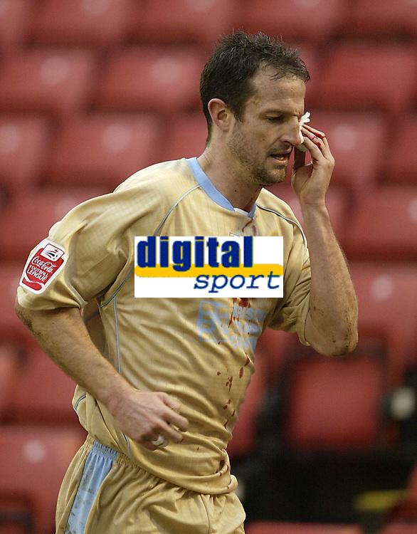 Photo: Aidan Ellis.<br /> Barnsley v Bristol City. Coca Cola League 1. 04/02/2006.<br /> Bristol's Louis Carey goes of to recieve treatmnt to a cut above his eye.