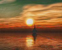 A sailboat sails on the horizon at sea during a beautiful sunset. <br />