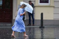 © Licensed to London News Pictures. 28/07/2021. Sheffield, UK. Α woman braves the rain in Sheffield as parts of Yorkshire are hit by heavy rain and thunderstorms. Photo credit: Ioannis Alexopoulos/LNP