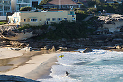 Sydney, Australia. Sunday 3rd May 2020. Surfers at Tamarama Beach in Sydney's eastern suburbs.The beach is now open to surfers and swimmers but no sitting or sunbathing  is allowed due to the COVID-19 pandemic.