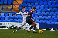 Tranmere Rovers defender Calum MacDonald tackles Bolton Wanderers defender Gethin Jones during the EFL Sky Bet League 2 match between Tranmere Rovers and Bolton Wanderers at Prenton Park, Birkenhead, England on 23 January 2021.