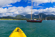 Kayak and sail boat on Hanalei Bay, North Shore, Island of Kauai, Hawaii