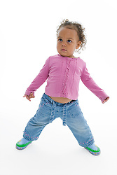 Portrait of a little girl playing in the studio,