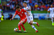 Slovakia midfielder Ondrej Duda tussles with Wales defender Chris Mepham during the UEFA European 2020 Qualifier match between Wales and Slovakia at the Cardiff City Stadium, Cardiff, Wales on 24 March 2019.