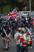 Loyalists of Northern Ireland marched with drums and flutes against the Northern Irish border Protocol in the city centre of Antrim on Friday, April 23, 2021. This is the fourth week of subsequent protests and marches since British loyalists renounced their support to the Good Friday Agreement in March this year. (Photo/ Vudi Xhymshiti)