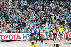 London, August 12 2017 . The crowd cheers the passing pack in the men's 5000m final on day nine of the IAAF London 2017 world Championships at the London Stadium. © Paul Davey.