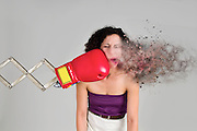 Mechanical boxing devices punches a young woman in the face