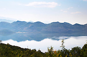 View over the vast lake and marshland Skadarsko Jezero on the border between Montenegro and Albania. Mountains in Albania on the far side. Montenegro, Balkan, Europe.