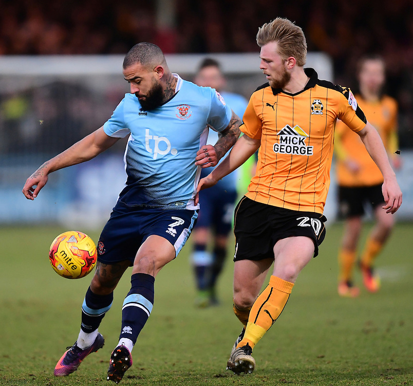 Blackpool's Kyle Vassell shields the ball from Cambridge United's Max Clark<br /> <br /> Photographer Chris Vaughan/CameraSport<br /> <br /> The EFL Sky Bet League Two - Cambridge United v Blackpool - Saturday 14th January 2017 - The Cambs Glass Stadium - Cambridge<br /> <br /> World Copyright © 2017 CameraSport. All rights reserved. 43 Linden Ave. Countesthorpe. Leicester. England. LE8 5PG - Tel: +44 (0) 116 277 4147 - admin@camerasport.com - www.camerasport.com