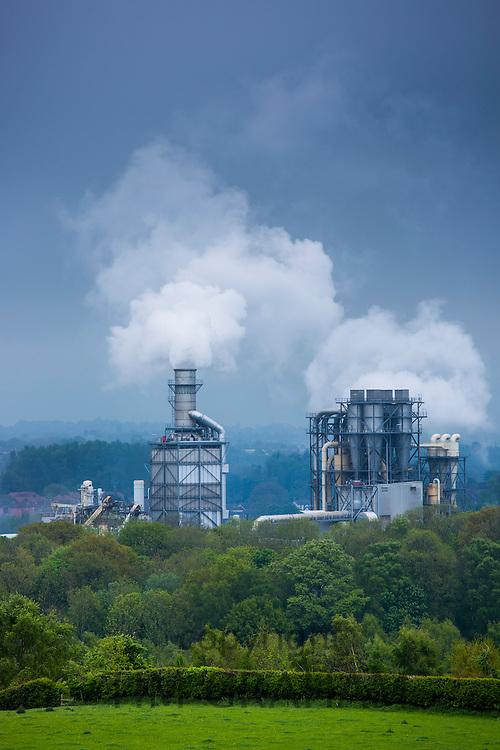 Steaming smoke stacks at Kronospan Factory making wood based panels, chipboard and MDF at Chirk in Wrexham, Wales