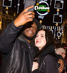 London, December 24 2017. Crowds grow in London's west end on Christmas eve as last minute shoppers hunt for gifts. Pictured: A couple take a Christmas selfie on Oxford Street. © SWNS