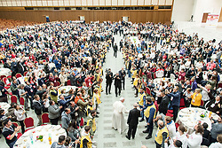 Pope Francis arrives to attend at lunch with the poor on the occasion of the Second World Day of the Poor, in the Paul VI Hall at the Vatican.