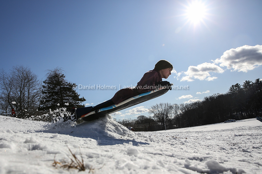 (1/19/20, FRAMINGHAM, MA) Marley Eggers, 13, of  Framingham, launches off a jump while sledding at Bethany Hill in Framingham on Sunday. [Daily News and Wicked Local Photo/Dan Holmes]