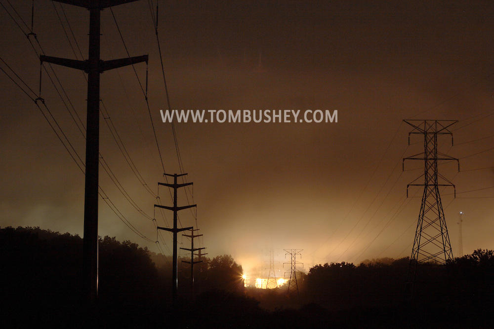 Middletown, NY  - Electric power lines are visible against the fog that formed after a storm on the night of July 23, 2008.