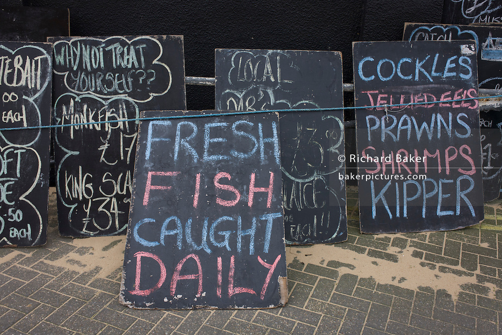 Seafood and shellfish on boards in Leigh-on-sea, Essex.