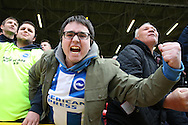 Brighton & Hove Albion fans celebrate after the final whistle. Skybet football league championship match, Charlton Athletic v Brighton & Hove Albion at The Valley  in London on Saturday 23rd April 2016.<br /> pic by John Patrick Fletcher, Andrew Orchard sports photography.