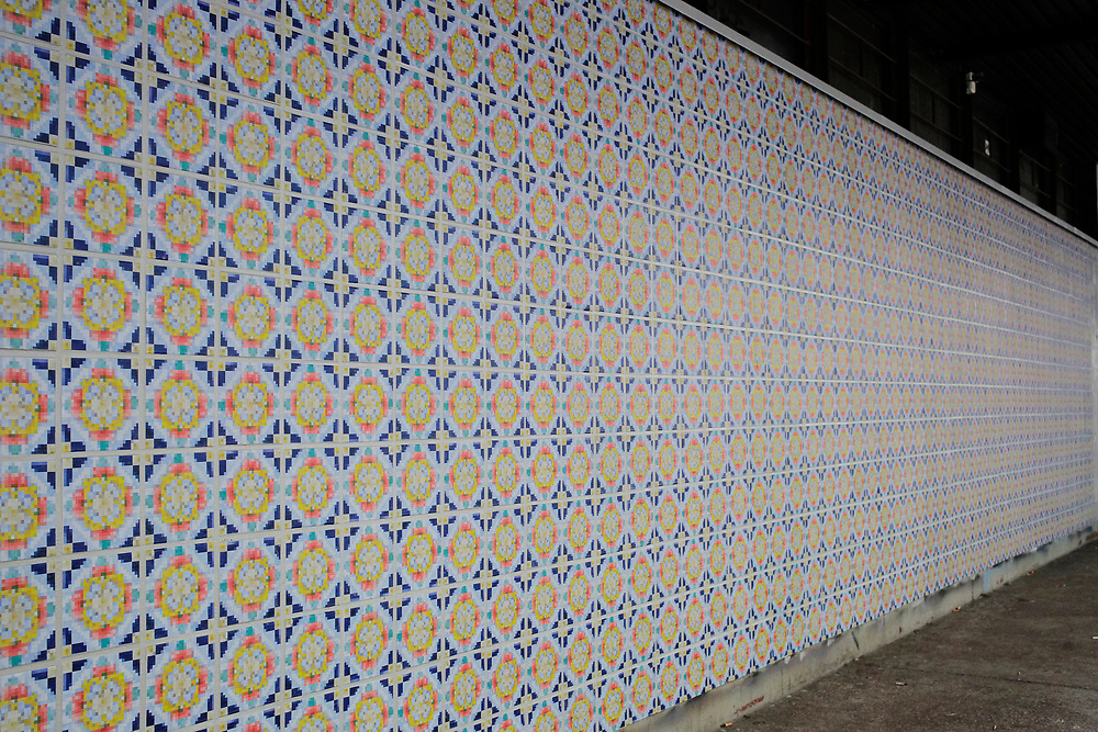 Helsinki public space 2014<br /> Wallpaper glue, digital c-prints on tilewall
