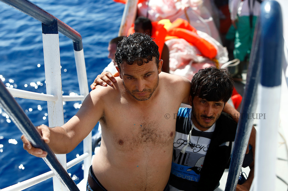 Migrants make their way to the upper deck of the Migrant Offshore Aid Station (MOAS) ship MV Phoenix after being rescued from an overloaded wooden boat 10.5 miles (16 kilometres) off the coast of Libya August 6, 2015.  An estimated 600 migrants on the boat were rescued by the international non-governmental organisations Medecins san Frontiere (MSF) and MOAS without loss of life on Thursday afternoon, according to MSF and MOAS, a day after more than 200 migrants are feared to have drowned in the latest Mediterranean boat tragedy after rescuers saved over 370 people from a capsized boat thought to be carrying 600.<br /> REUTERS/Darrin Zammit Lupi <br /> MALTA OUT. NO COMMERCIAL OR EDITORIAL SALES IN MALTA