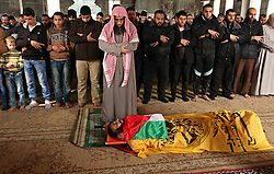February 9, 2017 - Gaza City, Gaza Strip, Palestinian Territory - Palestinians pray on the body of Mohammed al-Aqraa, who was killed in a tunnel explosion near the Egyptian border before his funeral, in Gaza City.  (Credit Image: © Ashraf Amra/APA Images via ZUMA Wire)
