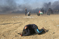 Palestinian protester suffering from teargas inhalation during clasheswith Israeli soldiers at the border fence with Israel east of Khan Yunis in the southern Gaza Strip, Israeli soldiers killed at least 60 Palestinians and wounded more than 2,700. as demonstrations on the Gaza-Israel border coincided with the controversial opening of the U.S. Embassy in Jerusalem. This marks the deadliest day of violence in Gaza since 2014. Gaza's Hamas rulers have vowed that the marches will continue until the decade-old Israeli blockade of the territory is lifted. Gaza Strip, Palestine, May 15, 2018. Photo by Ashraf Amra/SalamPix/ABACAPRESS.COM