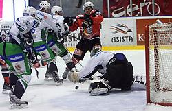 Marcel Rodman vs Ales Sila at 52nd round of EBEL league ice hockey match between HK Acroni Jesenice and HDD Tilia Olimpija, on January 29, 2009, in Podmezaklja, Jesenice, Slovenia. Acroni Jesenice won 5:3. (Photo by Vid Ponikvar / Sportida)