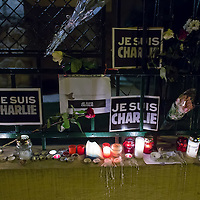 Flowers and candles lay in support for the terrorist attack victim staff of the Charlie Hebdo satirical weekly in front of the French Embassy in Budapest, Hungary on January 08, 2015. ATTILA VOLGYI