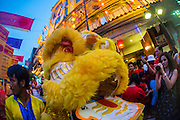 """09 FEBRUARY 2013 - BANGKOK, THAILAND:  Lion Dancers perform on Yaowarat Road in the heart of Chinatown in Bangkok on Chinese New Year. Bangkok has a large Chinese emigrant population, most of whom settled in Thailand in the 18th and 19th centuries. Chinese, or Lunar, New Year is celebrated with fireworks and parades in Chinese communities throughout Thailand. The coming year will be the """"Year of the Snake"""" in the Chinese zodiac.   PHOTO BY JACK KURTZ"""