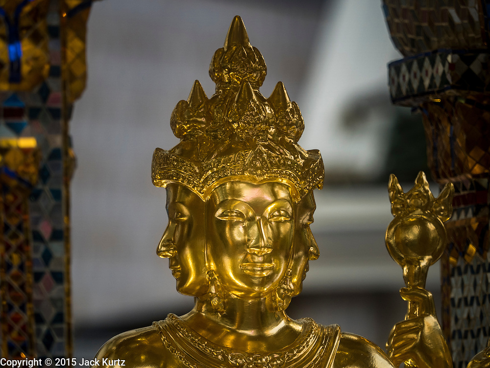 04 SEPTEMBER 2015 - BANGKOK, THAILAND: The repaired Four Faced Brahma statue at Erawan Shine Repairs to Erawan Shrine were completed Thursday, Sept 3 after the shrine was bombed on August 17. Twenty people were killed in the bombing and more than 100 injured. The statue of the Four Faced Brahma in the shrine was damaged by shrapnel and a building at the shrine was damaged by debris.         PHOTO BY JACK KURTZ