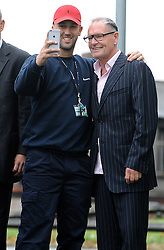 Former England footballer Paul Gascoigne poses for a selfie with a fan as he arrives at Dudley Magistrates' Court where he is set to face trial accused of a racially aggravated public order offence.