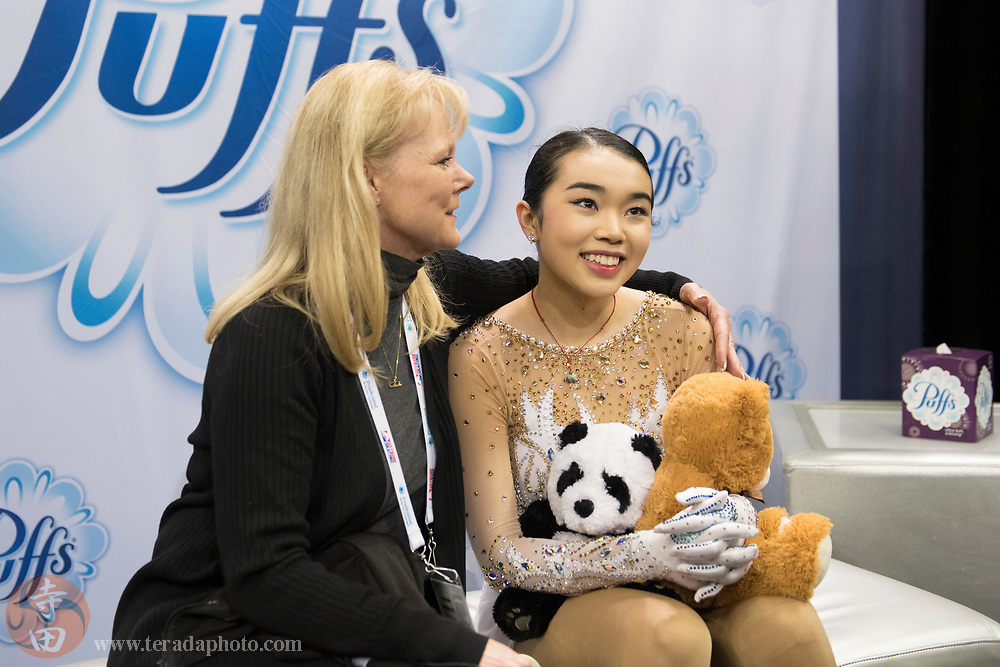 January 3, 2018; San Jose, CA, USA; Karen Chen (right) receives a hug from coach Tammy Gambill (left) in the kiss and cry after skating in the ladies short program during the 2018 U.S. Figure Skating Championships at SAP Center.