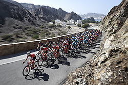 February 18, 2018 - Muscat, Oman - The peloton during stage 6 of the 9th edition of the 2018 Tour of Oman cycling race, a stage of 135,5 kms between Al Mouj Muscat and Matrah Corniche in Muscat, Sultanate Of Oman. (Credit Image: © Panoramic via ZUMA Press)