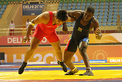Action during the Greco Roman Wrestling 96kg Semi Final between Anil Kumar of India and Kakoma Hugu Bella-Lufu of South Africa at the Indira Gandhi Sports Complex in New Delhi, India on the 5 October 2010..Photo by:  Ron Gaunt/SPORTZPICS/PHOTOSPORT