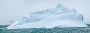 Antarctic glaciers compress years of snowfall into banded ice layers, which calve into the Southern Ocean as icebergs with odd shapes and patterns. Panorama was stitched from 3 overlapping photos.